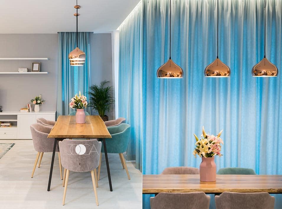 Zona de dining este la fereastra, lasand sa patrunda cat mai multa lumina. Blatul este realizat din lemn masiv trat, iar tapiteria scaunelor se potriveste perfect cu draperiile