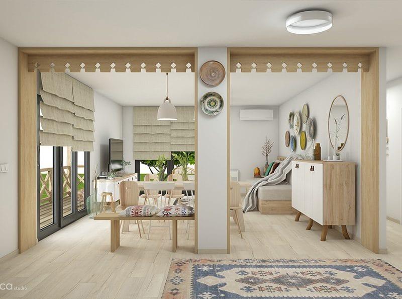 Interiorul casei container din Oltenia este amenajat simplu, inspirat din estetica caselor traditionale