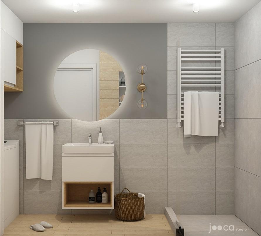 In baia pentru oaspeti, am optat pentru placi ceramice gri combinate cu texturi de lemn. Oglinda rotunda este simpla, cu o banda led care lumineaza din spate. Corpul de lavoar este simplu si are un cadru deschis la baza pentru depozitarea prosoapelor.