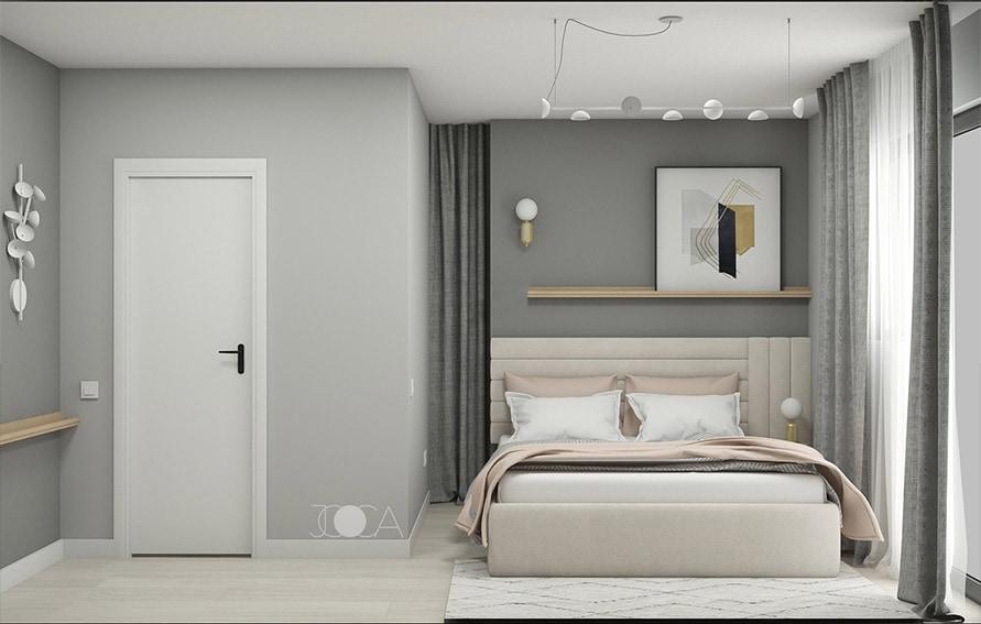 Pentru amenajarea dormitorului matrimonial, am ales un pat tapitat, cu o tablie la care ne-am jucat cu elementele grafice. Atmosfera este una light, in tonuri calde de gri.