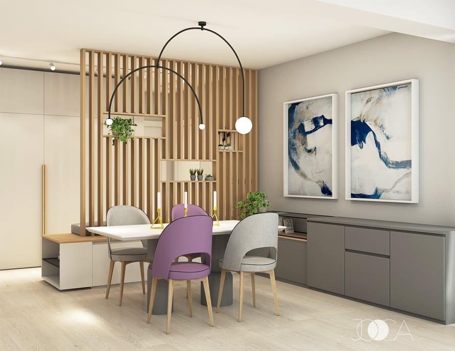 Zona de dining este separata de hilul de la intrare printr-un riflaj din lamele de lemn. Comoda gri din dreapta este folosita pentru vesela.
