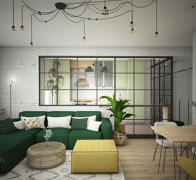 Openspace-ul este format din living si dining. Canapeaua verde din living este modulara si se completeaza cu taburetul galben. Covorul are un pattern geometric discret, iar masuta de cafea este din ratan. Masa de dining este din lemn masiv si acomodeaza patru persoane. In spatele canapelei exista un glazvant de sticla si delimiteaza openspace-ul de bucatarie.