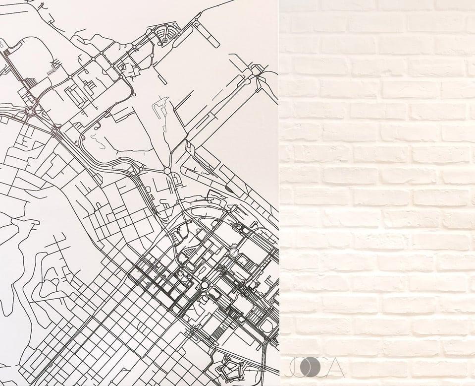 Harta orasului Cape Town si peretele din caramida aparenta alba decoreaza si lumineaza zona open-space-ului
