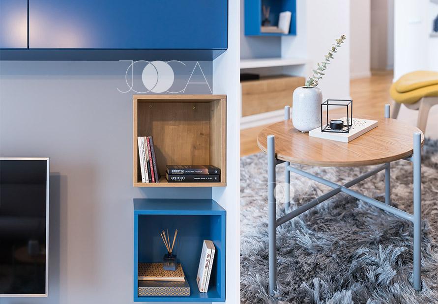 Gri-ul si accentele de albastru in combinatie cu lemn se regasesc in intreaga amenajare.