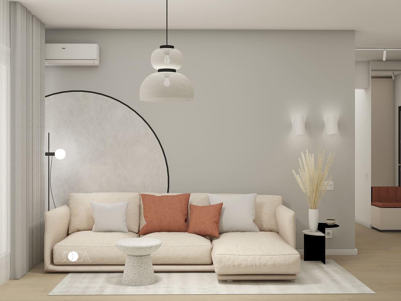 Amenajarea livingului in stilul Memphis, prin introducerea elementelor cu forme rotunjite.