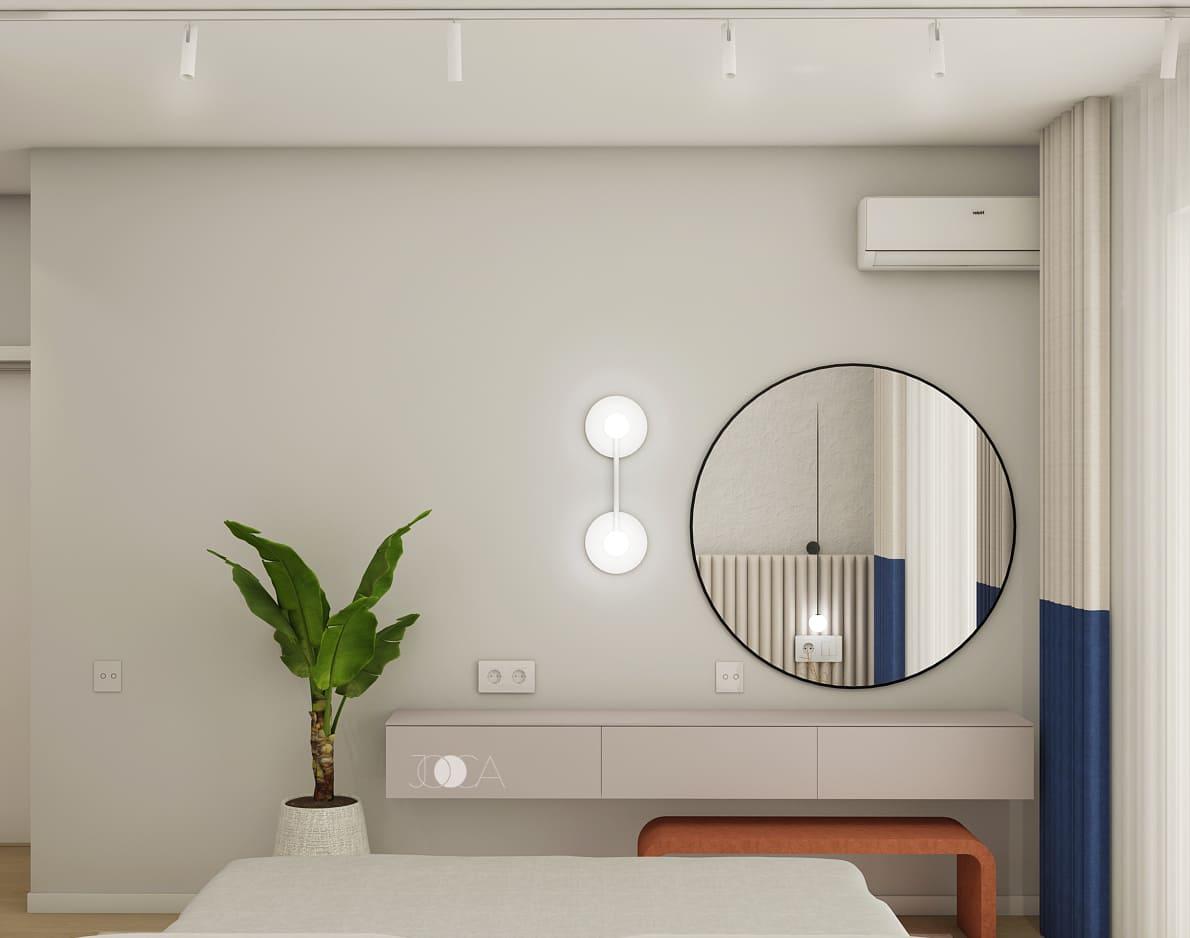 Oglinda rotunda, este un element des intalnit in amenajarea apartamentului Groovy Curves.