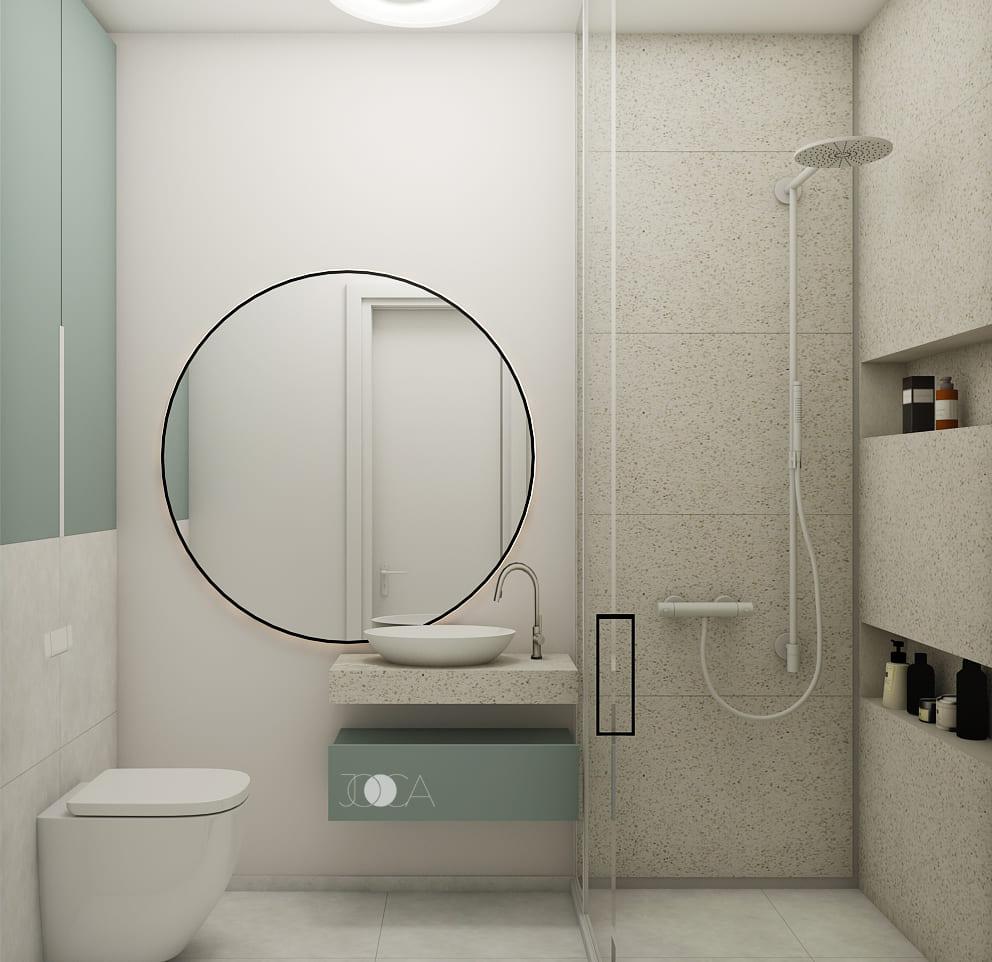 Pentru a mari spatiul, nu am placat toti peretii cu ceramica, si am amplasat o oglinda mare si rotunda.