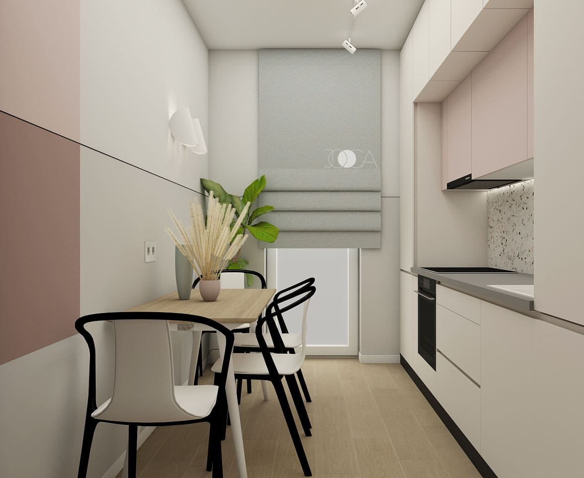 Bucataria este inchisa, iar mobilierul construit pana in tavan, oferta multiple posibilitati de depozitare.