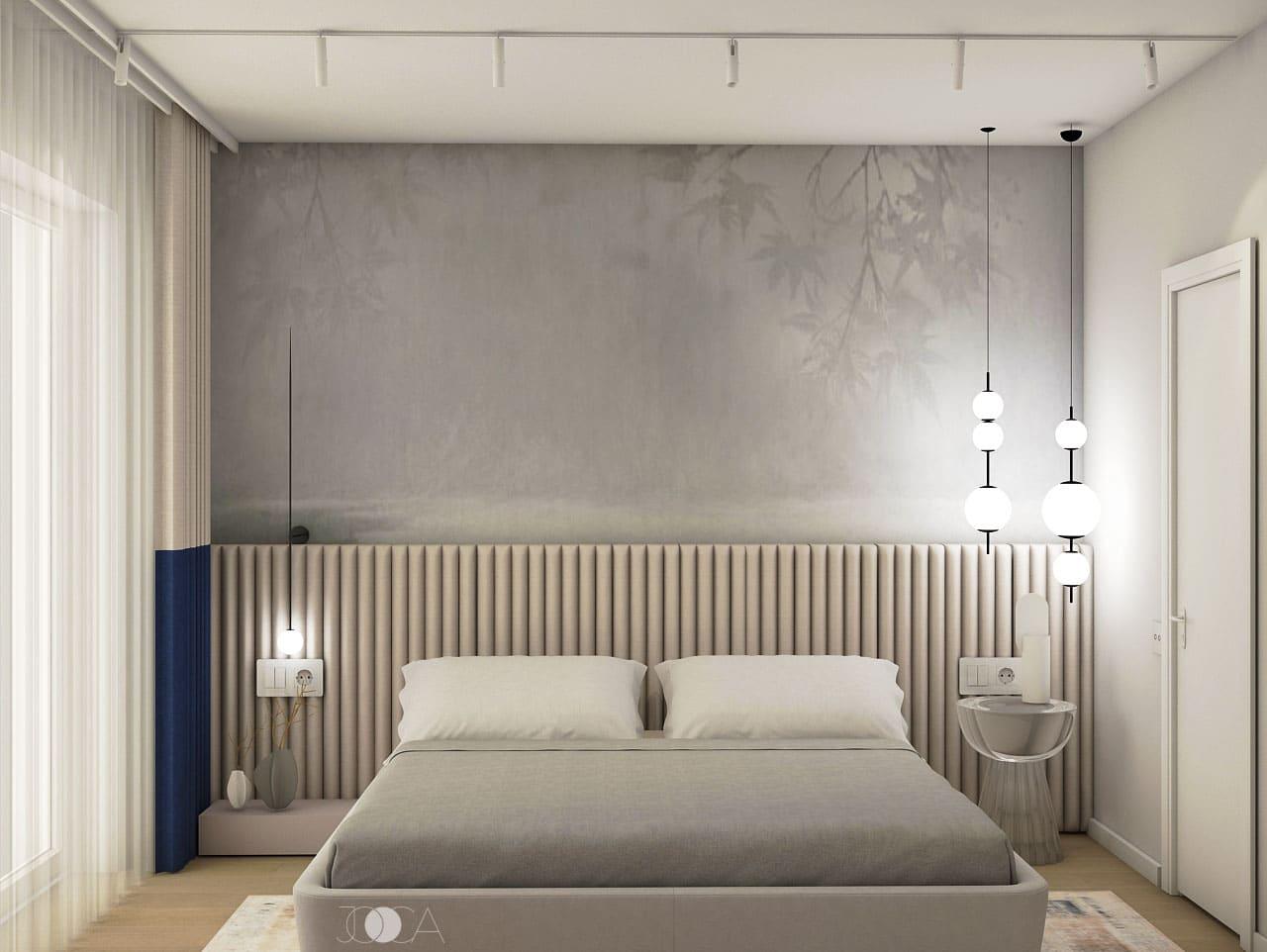 Tablia dormitorului este realizata din cilindrii din bureti, inveliti in material textil. Tapetul monocrom induce feeling-ul de spatiu intim.
