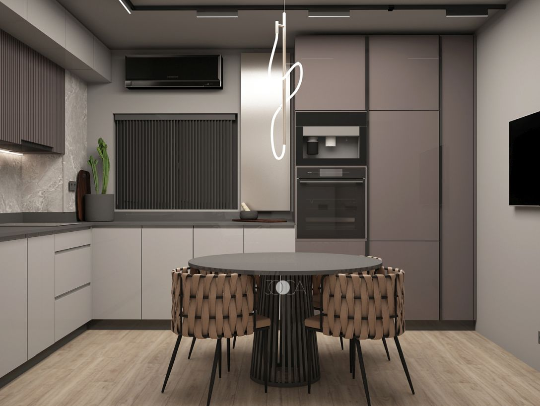 Mobilierul de bucatarie este simpla, iar accentul cade pe locul de luat masa.