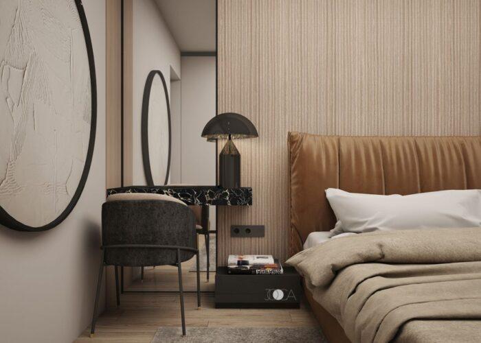 Patutul este tapitat cu o catifea coniac, iar zona de make-up ofera un aer elegant dormitorului matrimonial.