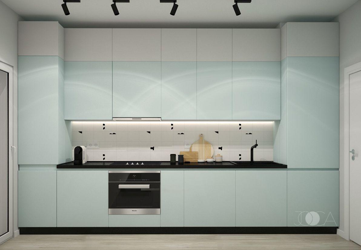 Bucataria este colorata intr-o culoare mint pastelata, combinata cu textura unor placi de terrazzo.