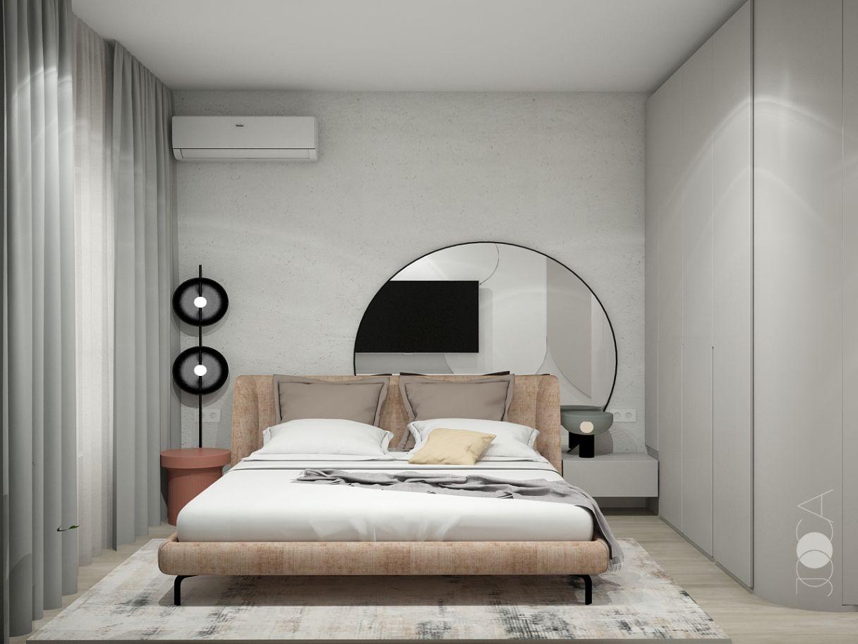 Dormitorul matrimonial are un vibe Neo-Memphis, iar accentul cade pe oglinda supradimensionata din spatele patului.