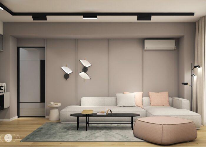 Canapeaua este joasa si confortabila, iar peretele din spate este decorat cu profile si vopsit uniform intr-o culoare calda.