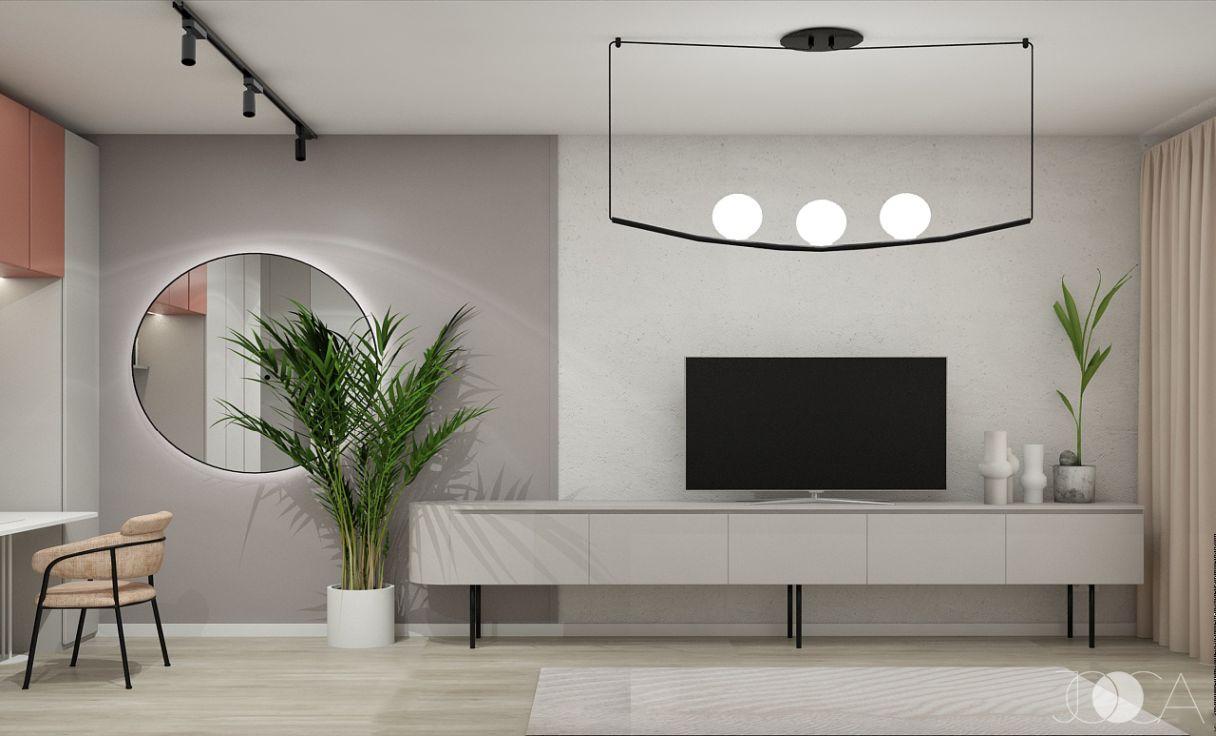 Comoda TV este suspendata pe picioare slim, cilindrice, iar peretele imbina o textura decorativa cu o lavabila simpla.